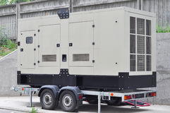 Commercial backup generator. A standby generator is a back-up electrical system that operates automatically. Stock Photo