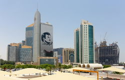Commercial bank tribute to Qatar Emir. DOHA, QATAR - JULY 26, 2017: Commercial Bank of Qatar`s skyscraper shows support for Emir, Tamim bin Hamad al-Thani stock image