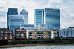 Commercial banking builldings overshadow residential homes at Canary Wharf, London Stock Photography
