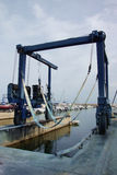 Commercial Boat Sling Crane Stock Image