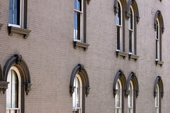 Commercial brick building with windows exterior Royalty Free Stock Photography