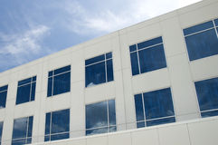 Commercial building. With reflective windows and partly cloudy blue sky Royalty Free Stock Photos
