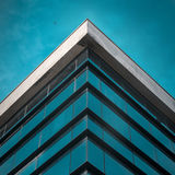 Commercial building exterior. Angle of building glass walls. Concept Of Modern Architecture royalty free stock photos