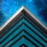 Commercial building exterior On Star Sky Background. Angle of building glass walls. Concept Of Modern Architecture royalty free stock images