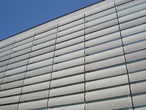 Commercial building facade plated with perforated metallic boards. Detail of commercial center facade in Amzei square in Bucharest Royalty Free Stock Photos