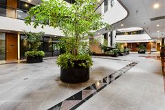 Commercial Building Foyer First Floor Area. This is nicely decorated, and a large first floor foyer area Royalty Free Stock Photo