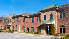 Commercial building. Red brick commercial buildings row with office space Royalty Free Stock Images