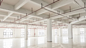 Commercial building under construction. Modern office building interior under construction Stock Photography
