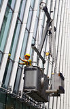 Commercial building window cleaner. Stock Photo