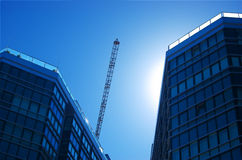 Commercial buildings with crane Stock Photos