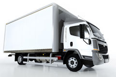 Commercial cargo delivery truck with blank white trailer. Generic, brandless design. Stock Photo