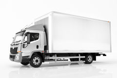 Commercial cargo delivery truck with blank white trailer. Generic, brandless design. Royalty Free Stock Images