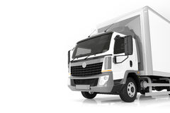 Commercial cargo delivery truck with blank white trailer. Generic, brandless design. Royalty Free Stock Photography