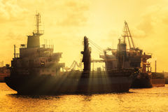 Commercial cargo  ships at sunset Stock Photography