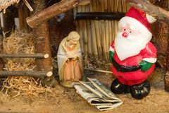 Commercial Christmas. Commercialism vs Christmas Mary Santa and Christ Stock Photography