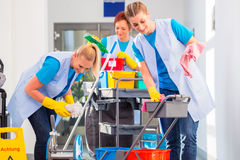 Commercial cleaners doing the job together Royalty Free Stock Image