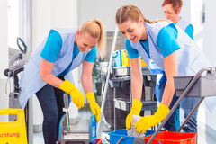 Commercial cleaners doing the job together Royalty Free Stock Photos