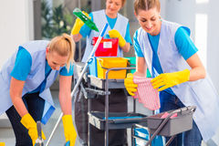Commercial cleaners doing the job together Stock Photos