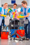 Commercial cleaners doing the job together Stock Images
