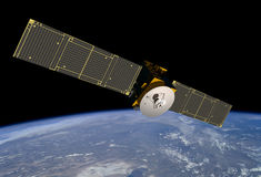 ORBITING HIGH TECH ELECTRONIC COMMUNICATION SATELLITE TECHNOLOGY. High tech communication satellite circling the world of technology concept. Navigation Stock Images