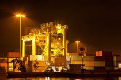 Commercial container port. Mobility Crane car in commercial container cargo port for shipping Royalty Free Stock Photos