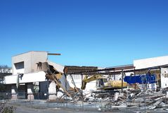 Commercial Demolition. A shopping mall or office complex being torn down Royalty Free Stock Images