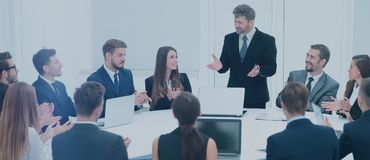 Commercial Director begins the workshop with business team. Commercial Director welcomed the business team before an important meeting .Business team with Stock Images