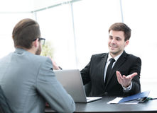 Commercial Director discusses current issues with employee at of Royalty Free Stock Photography