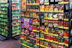 A commercial Display of Vegetable Seed Packets. A commercial display of vegetable and fruit seeds in packets arranged in rows Stock Photography