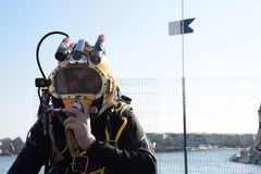 Commercial diver. With a helmet ready to dive in the oil and gas industry Royalty Free Stock Photos