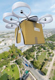 Commercial drone flying above a big city Royalty Free Stock Photography