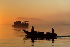 Commercial Fishermen at Sunset Stock Images
