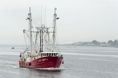 Commercial fishing boat Lucky Danny II crossing New Bedford outer harbor. New Bedford, Massachusetts, USA - June 2, 2018: Commercial fishing vessel Lucky Danny royalty free stock photography