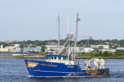 Commercial fishing boat Miss Madeline crossing Acushnet River stock photography
