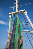 A commercial fishing boat with a net staged for a fishing trip.  stock image