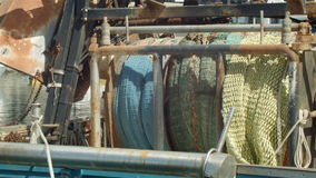 Commercial Fishing Boat with nets in harbour. Commercial Fishing Industry fisherman boats with fishing net waiting at docks stock video footage