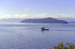 Commercial fishing boat in the ocean Royalty Free Stock Images