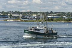 Commercial fishing boat Pilgrim leaving port Stock Images