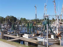 Commercial Fishing Boats. Shrimp boats with nets and other equipment at port in Apalachicola, Florida Stock Photos