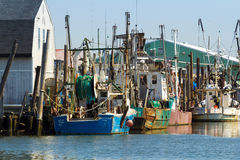 Commercial Fishing Boats in Belford, New Jersey. BELFORD, NEW JERSEY - April 11, 2017: Commercial fishing boats are docked at the Belford Seafood Cooperative stock image