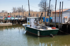 Commercial Fishing Boats in Belford, New Jersey. BELFORD, NEW JERSEY - April 11, 2017: Commercial fishing boats are docked at the Belford Seafood Cooperative royalty free stock photography