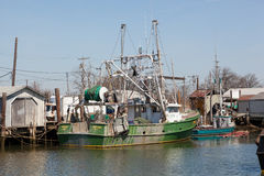 Commercial Fishing Boats in Belford, New Jersey. BELFORD, NEW JERSEY - April 11, 2017: Commercial fishing boats are docked at the Belford Seafood Cooperative royalty free stock image
