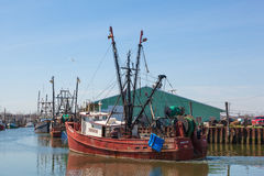 Commercial Fishing Boats in Belford, New Jersey. BELFORD, NEW JERSEY - April 11, 2017: The Donna Lynn fishing boat returns from sea at the Belford Seafood royalty free stock photography
