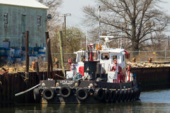 Commercial Fishing Boats in Belford, New Jersey. BELFORD, NEW JERSEY - April 11, 2017:  The Little Toot Tug Boat is docked at the Belford Seafood Cooperative Royalty Free Stock Photography