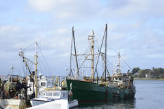 Commercial fishing boats in a harbor Royalty Free Stock Photography