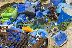 Commercial fishing nets and plastic boxes discarded on the quayside at Warsash on the south coast pf England in Hampshire royalty free stock photography