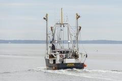 Commercial fishing vessel Wisdom leaving New Bedford on hazy morning. New Bedford, Massachusetts, USA - May 1, 2019: Scalloper Wisdom heading into Buzzards Bay stock photos