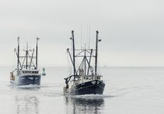 Commercial fishing vessels Blue Delta and Blue Cove returning to Royalty Free Stock Photos