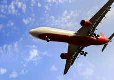 Commercial flight airplane flying on blue sky in travel tourism concept Stock Photography