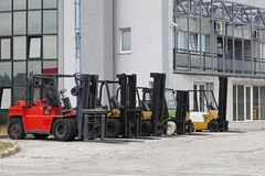 Forklifts. Commercial forklifts in front of distribution warehouse Royalty Free Stock Image